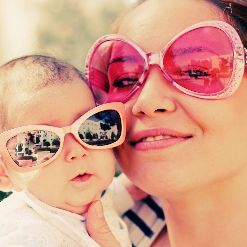 Portrait of mom and her baby outdoors