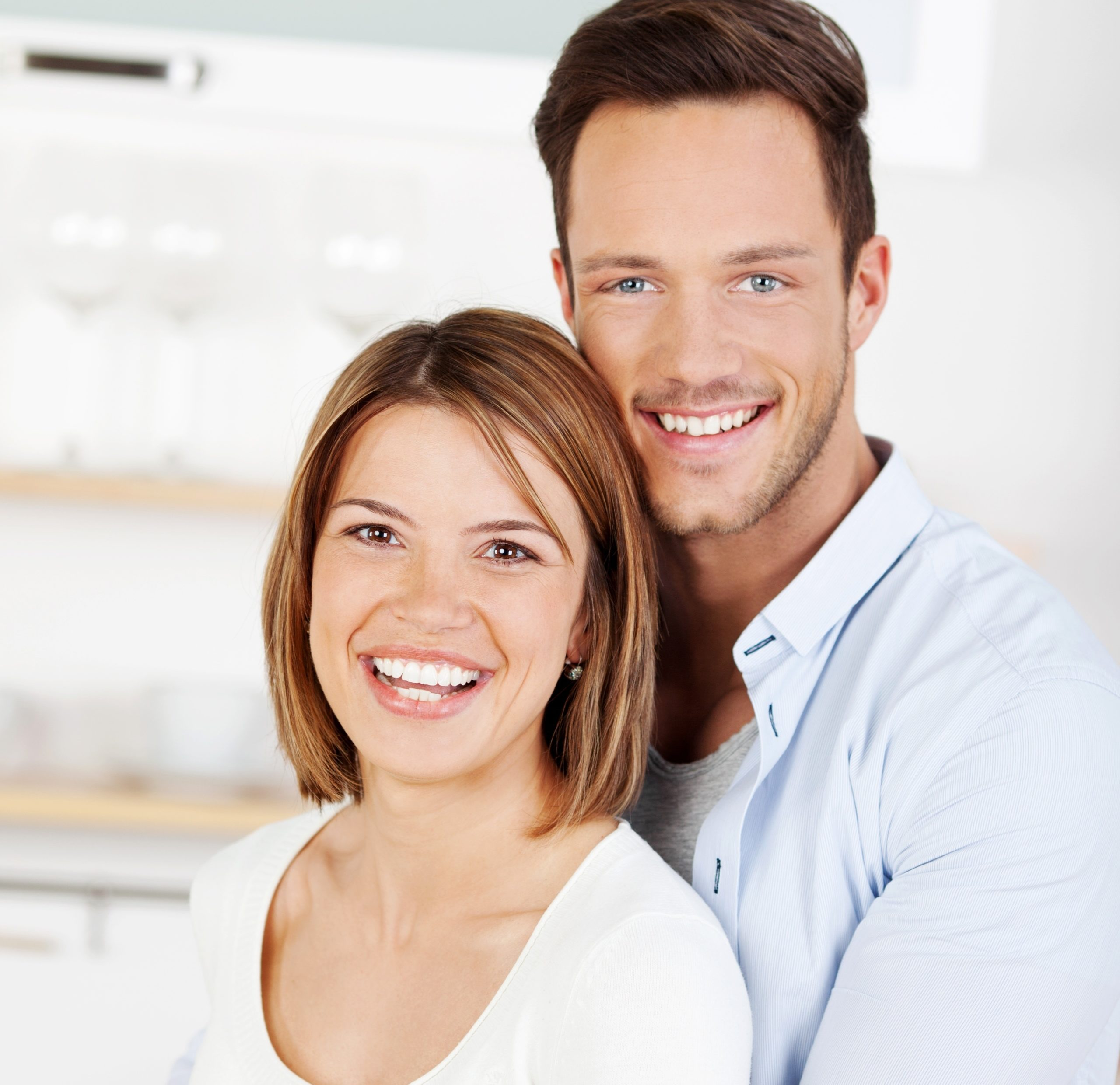 21162505 – happy couple at home in their kitchen